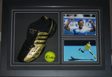 Signed tennis shoe and ball